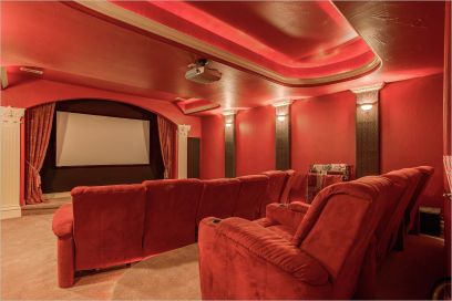 a red theater room in a home for sale