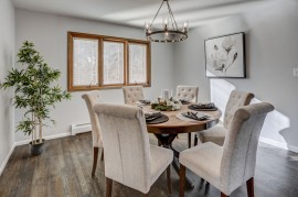 A handsome table is set in a home for sale