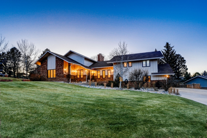 Dusk photo of a multi-level home for sale